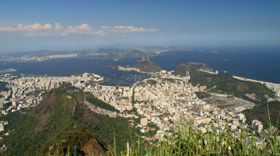 View from the top of Corcovado.  Sugerloaf Mountain can be seen in the distance.