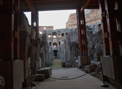 Under the arena foor.  Where slaves, gladiators, and animals were kept.