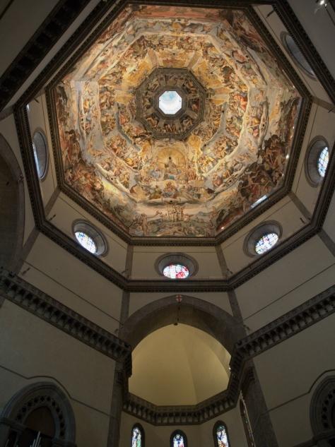 Inside Basilica di Santa Maria del Fiore looking up at the dome.