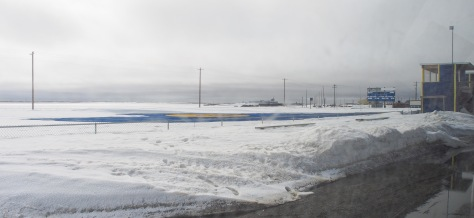 Blue astroturf football field.